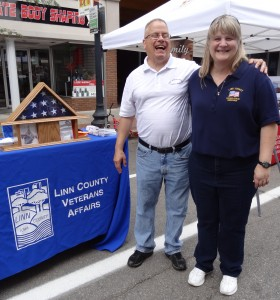 Don Tyne and Karla Elm in front of our booth.